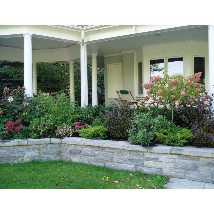 Raised garden around front porch