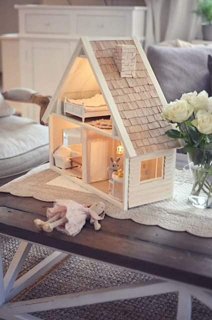 Love the bunny in the white shabby dollhouse!