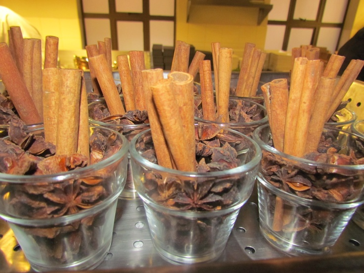 Ani star seed and cinnamon sticks planted in small glass pots and placed on the tables to fill the room with a light sweet and spicy scent