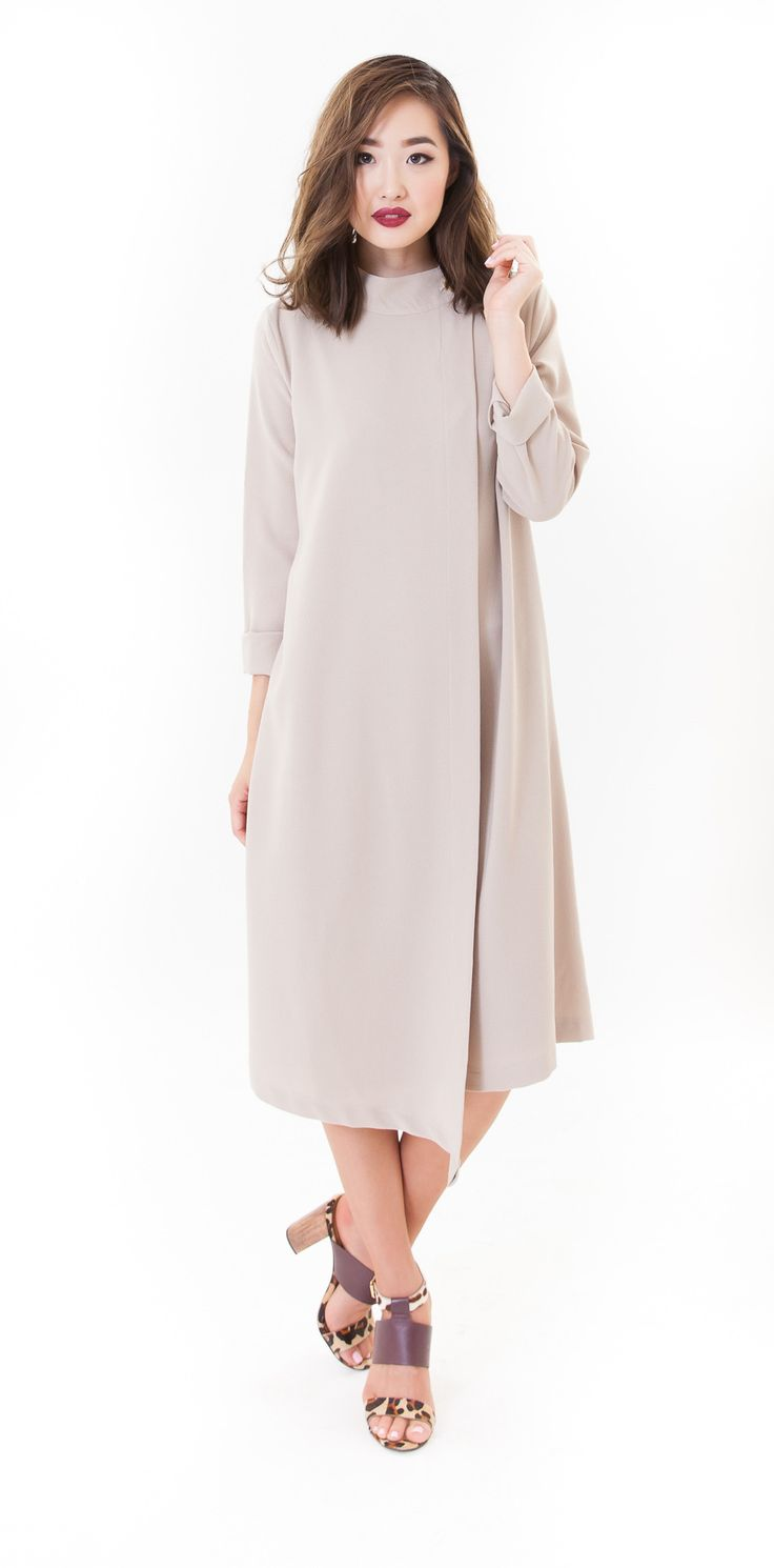 Modest long sleeve midi length aysemterical hem dress