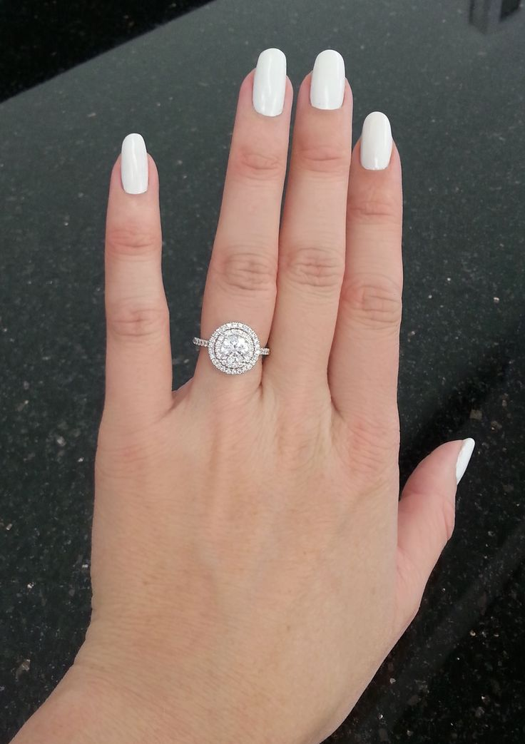 Celebrity engagement ring trend: double halos. Love the look? Find your own, like this style from Jeff Cooper Designs. (Doesn't white nail polish go perfectly with diamonds?)