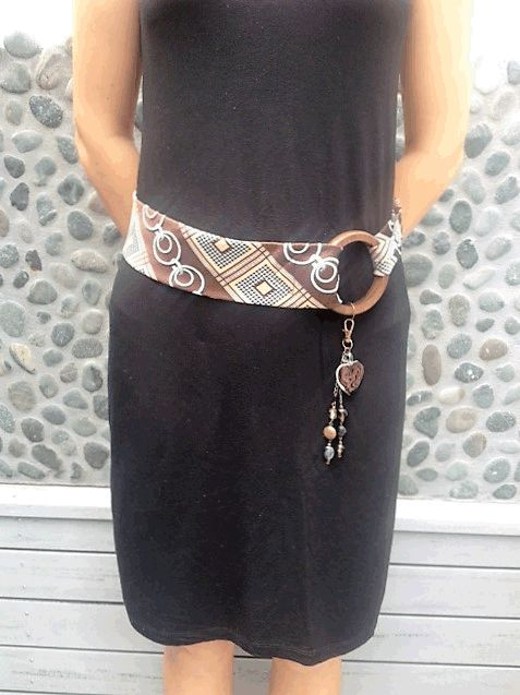 A recycled tie made into an adjustable belt