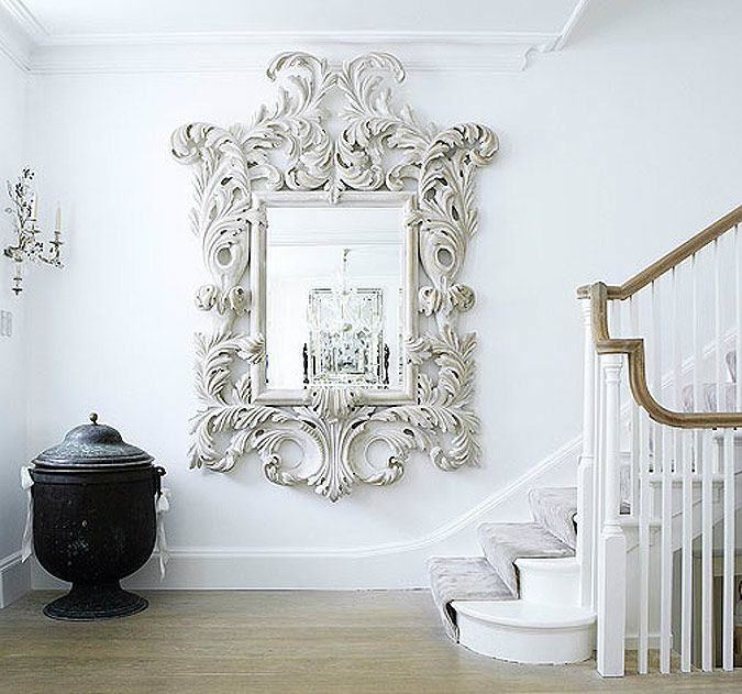 A mirror both Baroque and whimsical.