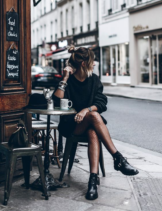 Black sweater dress, fishnet tights & black leather lace-up boots | @styleminimalism