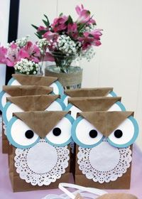 Favor bags and other decor for a toddler owl party// Such angry owls. Place black circles further apart to give less angry look.