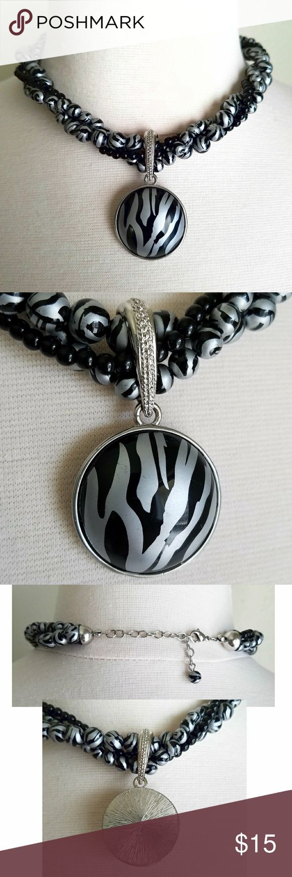 "Zebra Black Beaded Pendant Statement Necklace Layers of zebra print and solid black beads. Black and silver zebra animal print pendant with silver metal clasp and back. Necklace length (end to end)- adjustable 16.25""-18.5"", Pendant- 1 1/8"" diameter . Good used condition (few minor scratches). Jewelry Necklaces"
