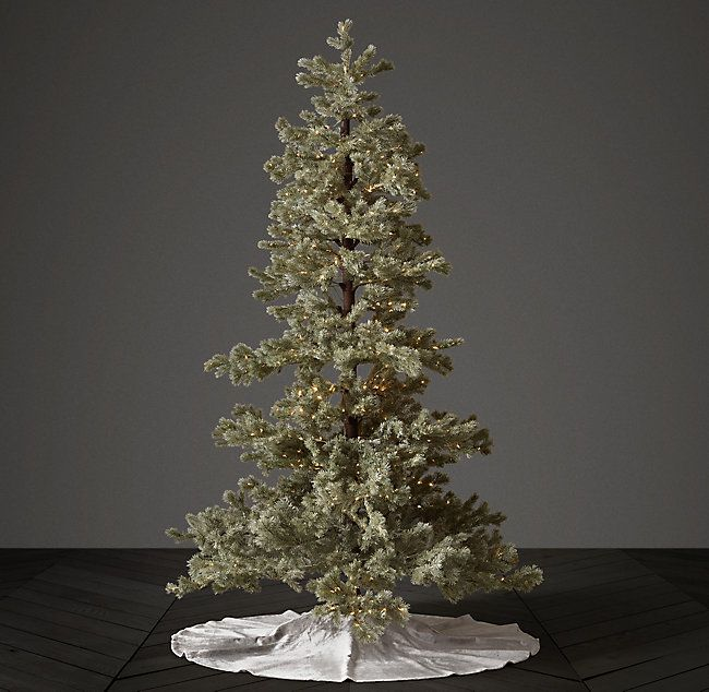 RH's Faux Blue Spruce Starlit Tree with Illuminate Technology:Our Faux Blue Spruce Starlit Tree makes a shimmering statement with Starry Light LEDs that illuminate as trunk sections are connected. The hand-wrapped branches are adjustable for artful ornament placement and feature lifelike tips.