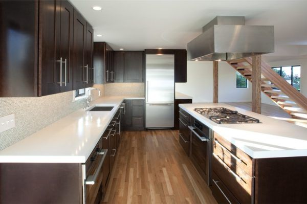 white kitchen cabinets with dark brown countertops and 5 burner gas ...