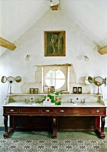 Huge, antique sink and accessories. Look at the window installation- love this decaying look.