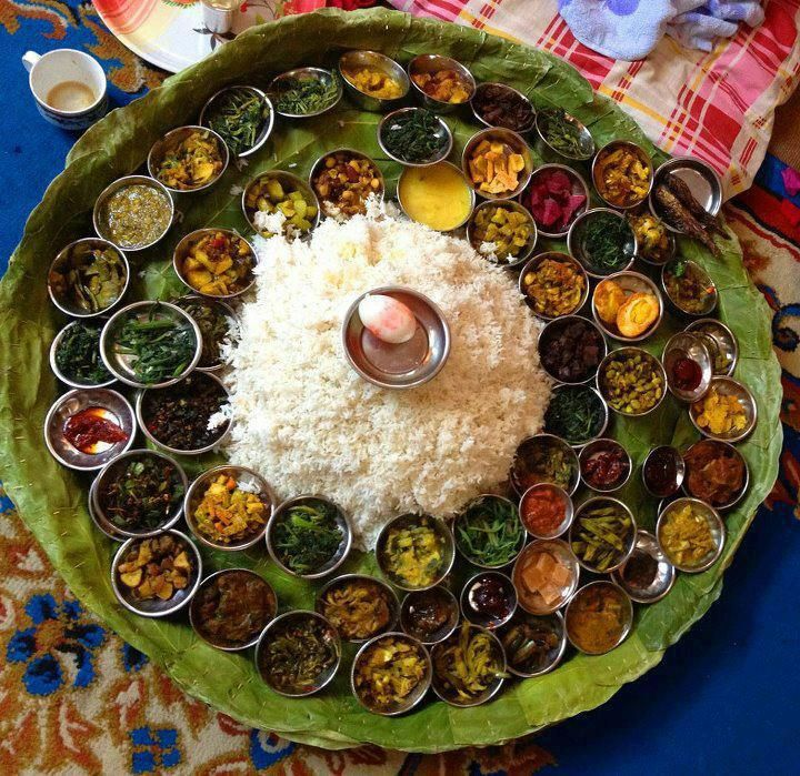 """South Indian Thali - typical food eaten for lunch or dinner in India. The word """"Thali"""" means """"large plate"""". It could consist of 4 types of shaak/subji made with potatoes, okra, beans, chickpeas etc, raita - indian yogurt, pickles, lentils, vegetables, paratha (flaked indian bread), Daal (spicy indian lentil soup), a Indian sweet (mithai) and is one of the most healthiest meals."""