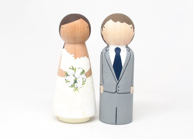 Custom Cake Toppers Wedding with Flowers by Goose Grease - Hand Painted Wooden Dolls. $100.00, via Etsy.