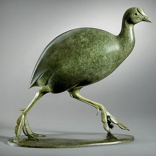 A beautiful green coot in action, running here and there while its feet slap on the wet ground. This is one of the artist's typical sculptures of water birds. Released in an edition of twelve.