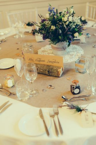 wedding table name card holders in logs