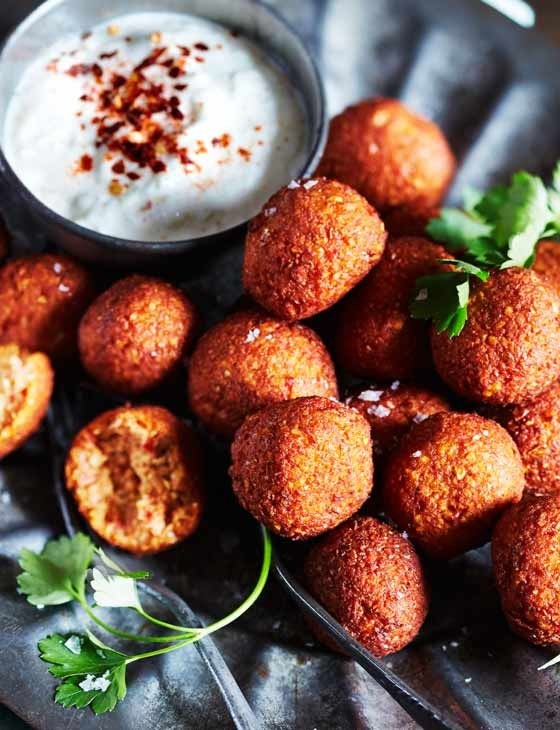 Try some spiced red pepper falafel with smoky yogurt dip for a soft, savoury Middle Eastern nibble.
