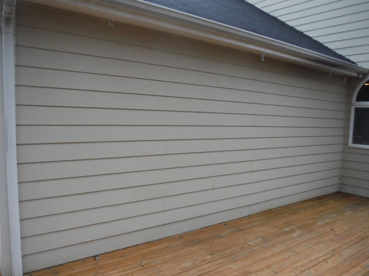 Before picture of old Masonite siding on the deck : hardboard garage door - pezcame.com