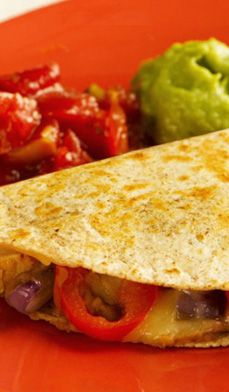 Light & Easy Chicken Quesadillas - Made with marinated chicken, refried beans, onions and peppers, these quesadillas are hearty and filling.