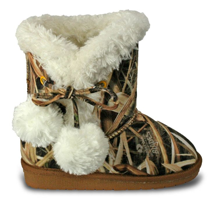 The DAWGS Girls Mossy Oak® Side Tie Boot features signature Mossy Oak© camo designs that are fun and funky and a side tie double pom pom design. Faux shearling lining and comfort memory foam insole pr
