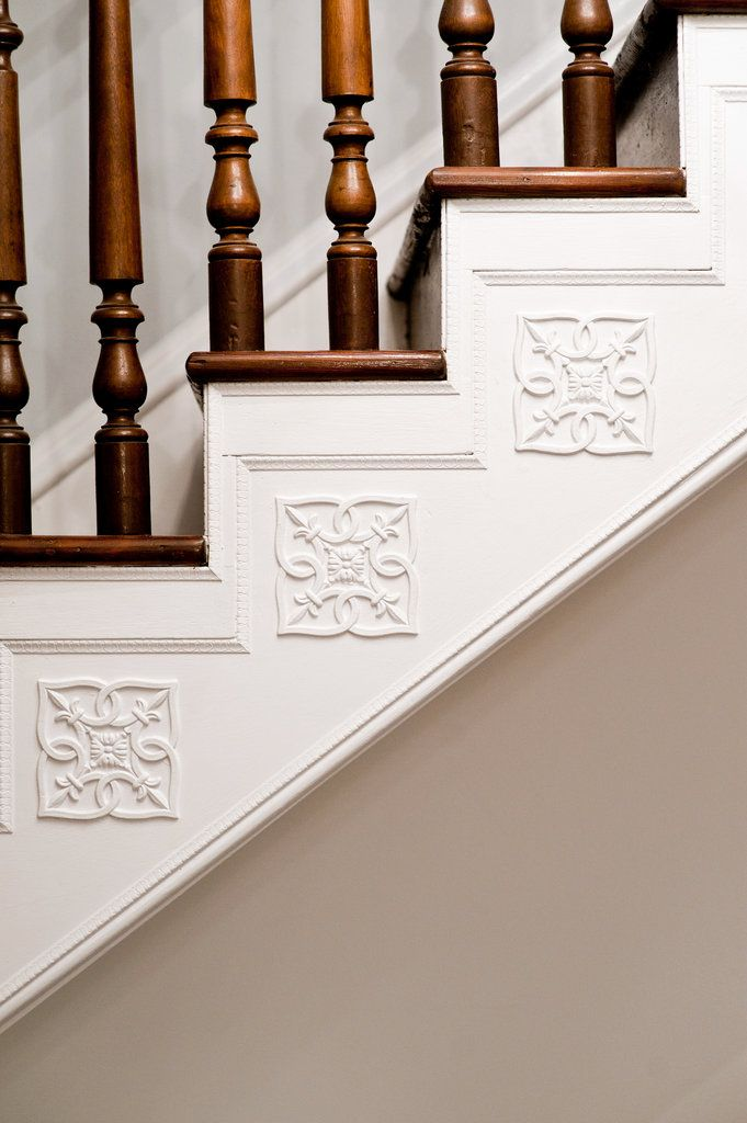 Decorative details on staircase (could be done with wooden apliques and some paint)