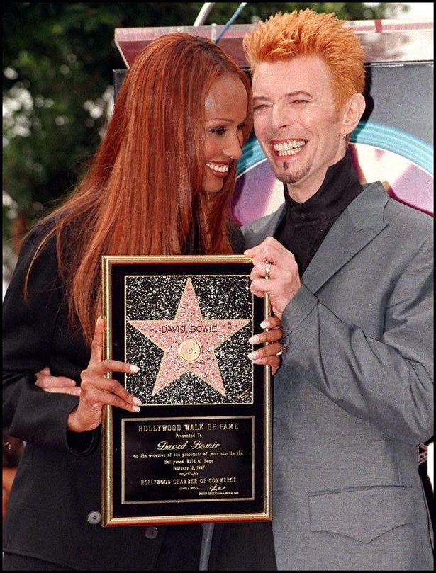 David Bowie holding award