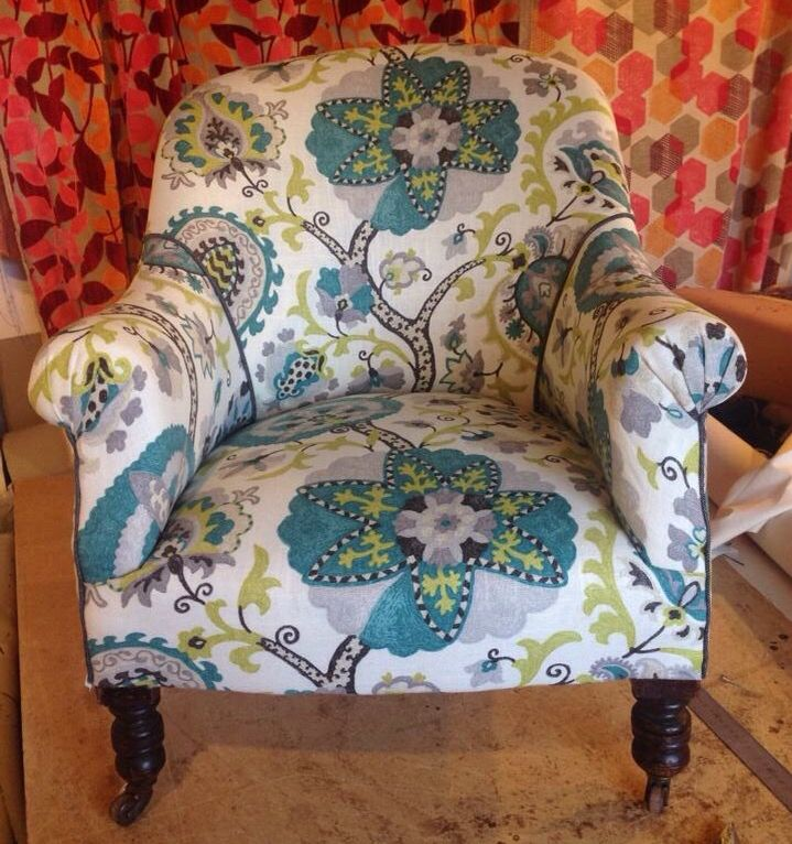 Armchair recovered in James Dunlop fabric.