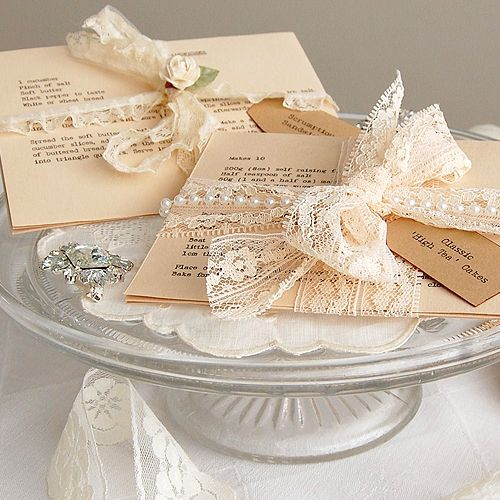 Cute Gift: Vintage looking pearls and lace favors for guests to pick up following an afternoon tea party....teaparty recipe cards..lovely decorations to grace the tea tables as well