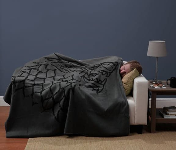Pin for Later: 105 Awesome but Affordable Gifts For Men Game of Thrones Blanket Winter is coming, so snuggle up in this Game of Thrones blanket ($20-$35). Choose between the emblems of House Stark or House Targaryen.
