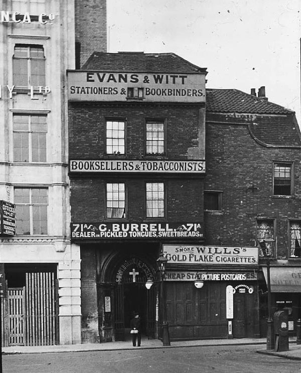 Bookseller &  Tobacconist and Dealer in Pickled Tongues at the entrance to St Bartholomew's, Smithfield, c. 1910