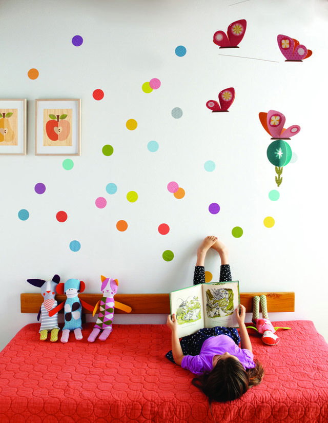 A gorgeous colourful room complete with dot wall decals, if Kate spade designed a room I think it would look like this