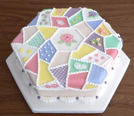 Patchwork fabric birthday cake    Violeta shares her mother's love of all kinds of needlework. She'd also love the cheery colors, pretty patterns and lovely flowers on this cake.