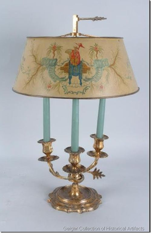 This bouillotte lamp belonged to Jacqueline Kennedy Onassis! She loved this Louis XV style lamp so much that she took it from their home in Georgetown to the West Sitting Room in the White House and finally to her New York apartment. It went up for auction with the Geiger Collection of Historical Artifacts in 2007 with an estimated value of $35,000 to $50,000. I love the hand-painted Chinoiserie on the shade!