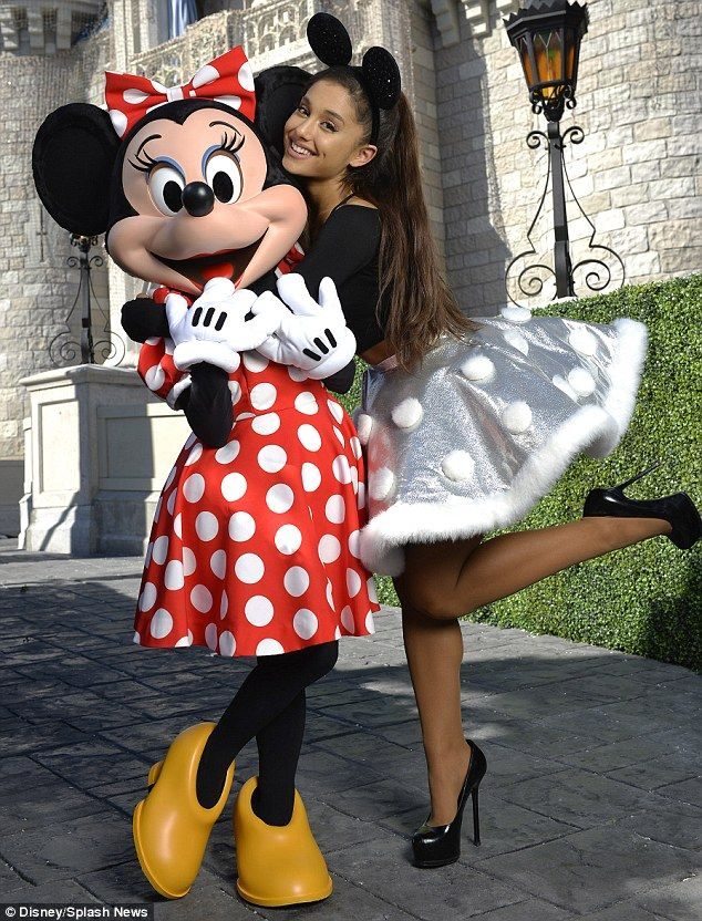 Holiday spirit: Ariana Grande, 22, made an appearance at Walt Disney Word on Wednesday where she taped a special performance for the park's annual Christmas special