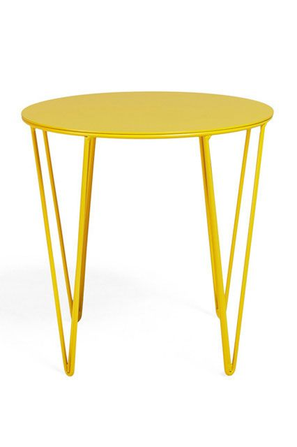 Bright as sunshine, this sturdy steel table makes a perfect sidekick for a cozy, worn-in reading chair.