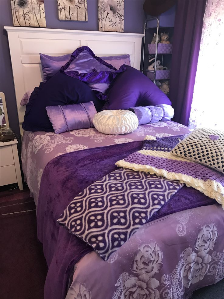 Purple, bed, bedspread, wall, pillows, rug, blankets, mat