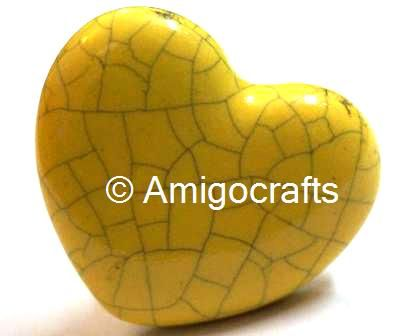 http://www.amigocrafts.com/ProductDetail.aspx?m=0&c=0&sc=22&q=1151&tag=Yellow%20Heart%20Crackle%20Knob