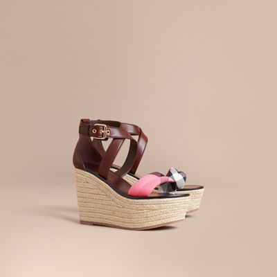 Leather and House check sandals raised on a 9cm/3.5in platform espadrille wedge heel. The warm-weather style features a wrap-around leather ankle strap with buckle to finish.