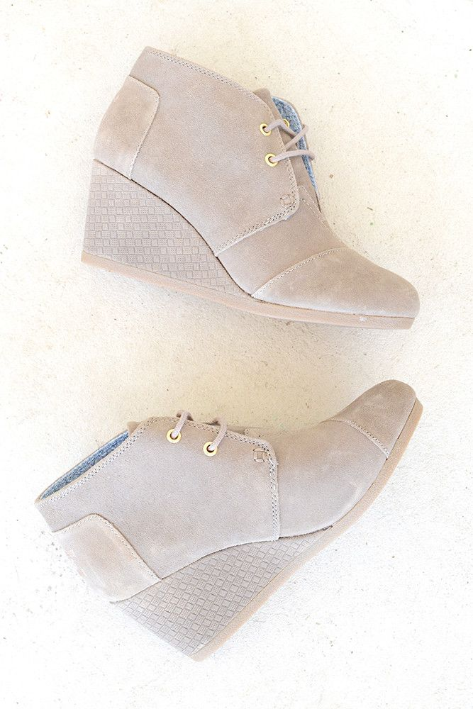 A classic and chic bootie that is high on comfort and style. Dress up or down, this TOMS shoe will be sure to be a staple in your wardrobe. Adorned with an embossed heel. With every pair of TOMS shoes