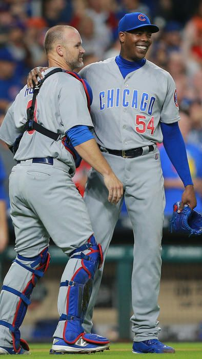 Aroldis Chapman is hugged by David Ross after the final out. Cubs 2, Astros 0. September 9, 2016. (Bob Levey / Getty Images)