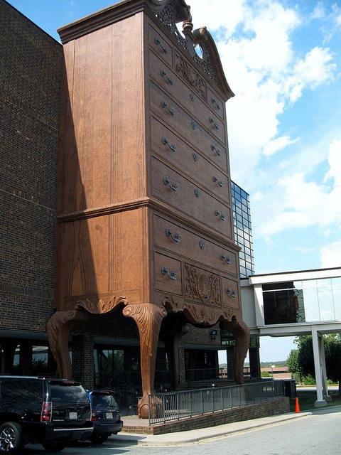 The front of Furnitureland South in High Point, NC, is a gigantic highboy. Featured on http://www.mentalfloss.com/blogs/archives/74157. Photo by Flickr user joanna8555.