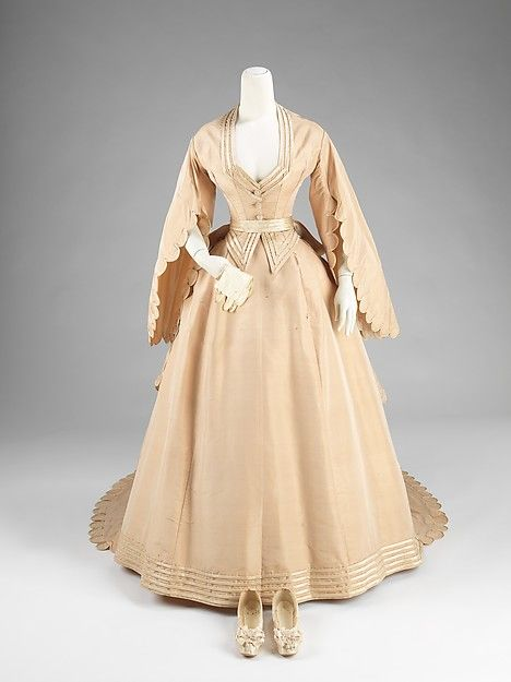 <3 Vintage Fashion: 1870s-1880s [{Wedding Ensemble} MANUFACTURER: Courvoisier DATE: 1870 CULTURE: American MEDIUM: silk, leather CREDIT: Brooklyn Museum Costume Collection at The Metropolitan Museum of Art, Gift of the Brooklyn Museum, 2009; Gift of Mrs. Charles Iseley, 1964.]