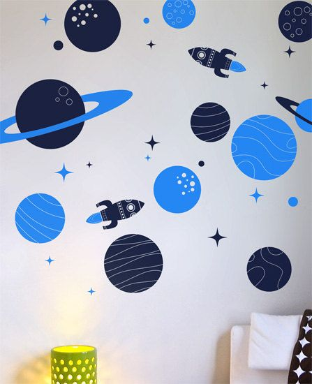 A pack of planets and two super rockets to orbit around your childs bedroom. Measurements: 11 planets, 12 stars, 2 rockets. The largest planet: 59.5cm