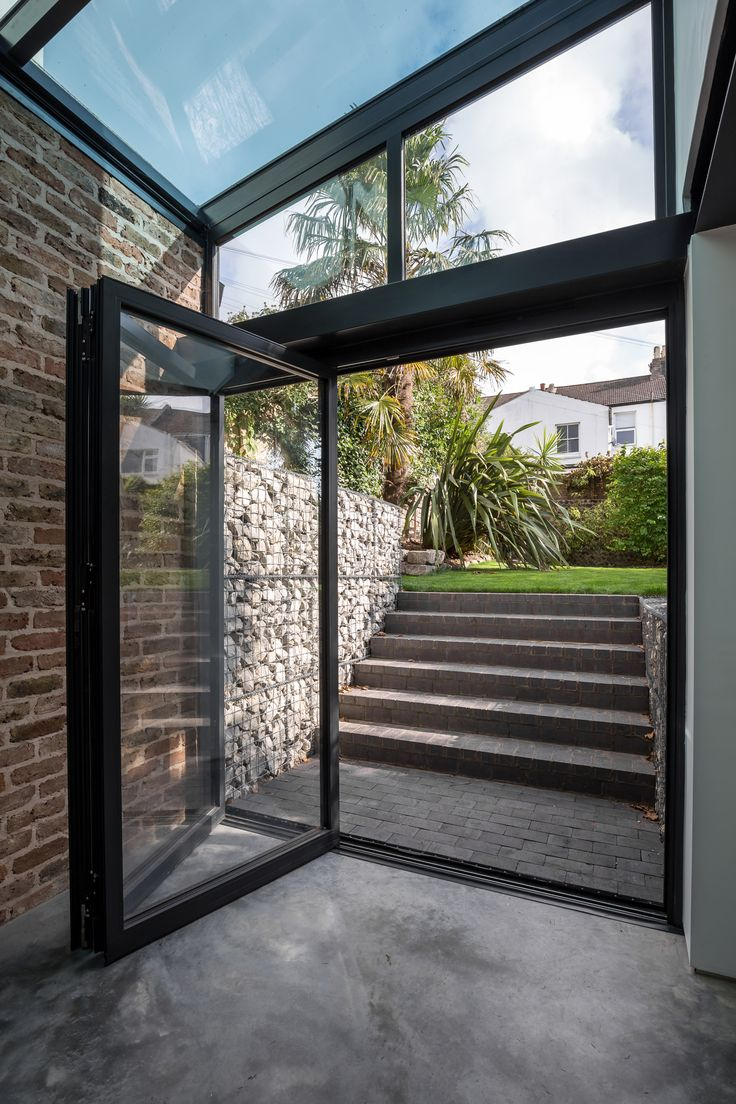 Single storey home flat roof future vertical expansion 6 social side - Side Extension Glass Roof Double Doors Brick Walls Extensions Bricks