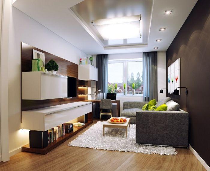 salones con encanto, salón bien iluminado con sofá ghris y tapete blanco, estanterías de madera y mesa de café, cojines verdes