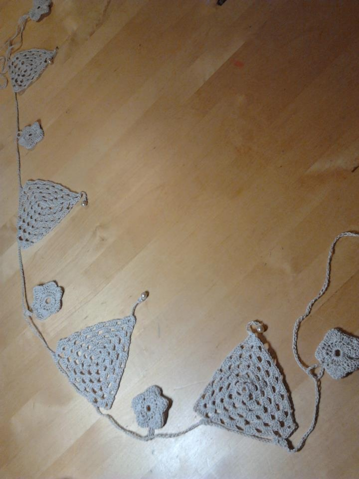 I made this crochet bunting.  Combination of triangle flags and little daisy flowers
