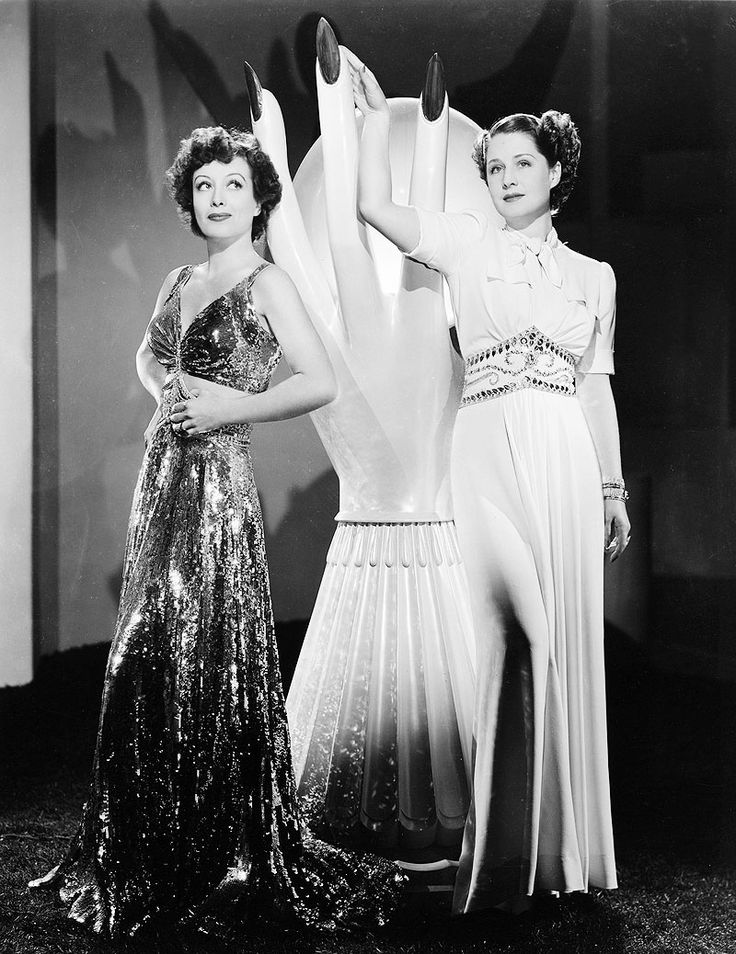 "Joan Crawford as 'Crystal Allen' and Norma Shearer as 'Mary Haines' in ""The Women"" (1939)"