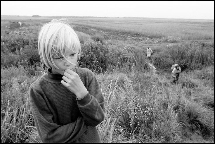 Paul Fusco |  BELARUS. Maiskey Village. 2000. This potato field is near the Hot Zone, a 30 km zone around Chernobyl which was horrifically radiated. These women and this young girl are harvesting the potato crop which are all contaminated from growing in the tainted soil.