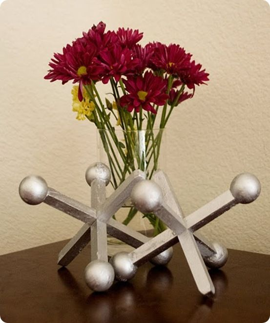..I don't know why I want to make these but I do...these are so cute. Jacks using dowel rods and wooden balls.  Tutorial here.