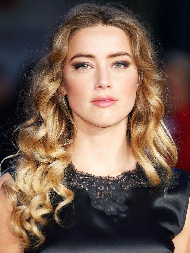 Amber Heard with honey bronde hair.