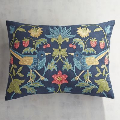 Springtime drama: Our handcrafted, embroidered pillow depicts mirror-image bluebirds among colorful flowers on a striking navy background. Highlighted with metallic thread, this oblong beauty will perform solo or as part of an ensemble on your sofa, chair or bed.