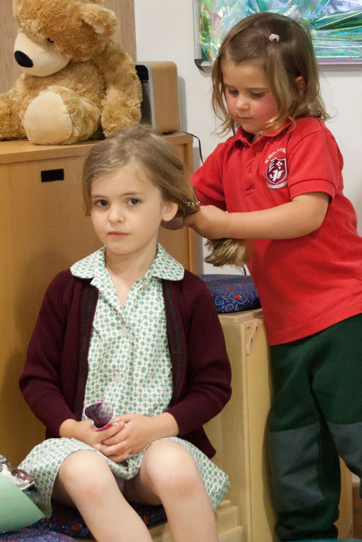 At the hair dresser's - children love to re-enact real-life scenarios in the role play corner.