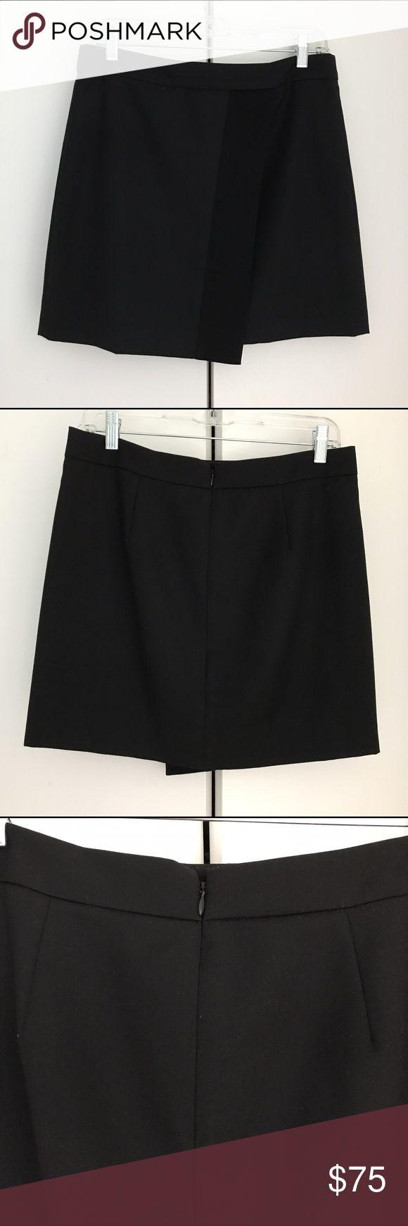 J. Crew Origami skirt in tux stripe Black J. Crew Origami skirt in tux stripe. Sits at waist. Hidden back Zipper. Fully Lined. 16 1/2 inches long. Falls above knee. 50% polyester, 50% wool; Tuxedo stripe trim 82% triacetate, 18% polyester; Lining 100% polyester. J. Crew Skirts